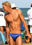 BLONDE BOY IN BLUE TRUNKS