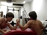 Shirtless strong teens armwrestle