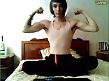 Beautiful teen flexes his muscles