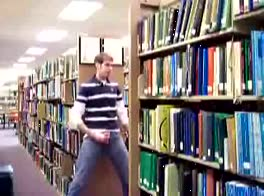 boy jerks off in the library