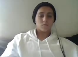 White sweater boy on webcam