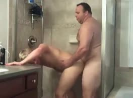 big man in the shower with young