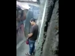 a worker is caught jerking in a small street