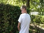 Guy peeing on a tree at a School