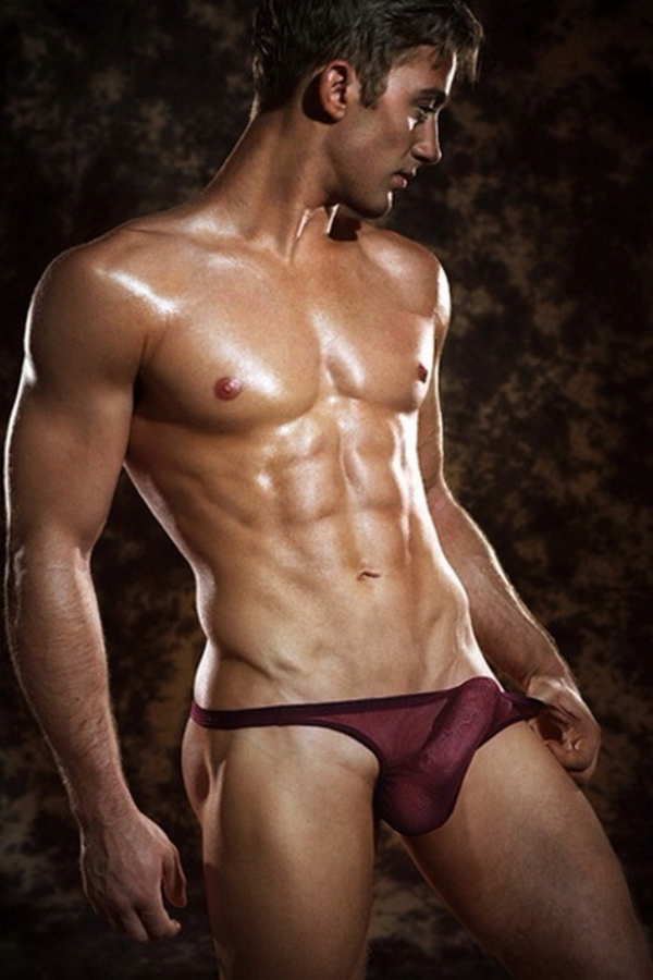 Attractive young man with muscular naked body stock image