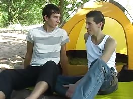 Two Russian boys in front of a tent