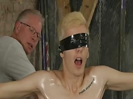 BDSM blond boy tied, whipped and jerked to cum