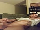 Tatted guy shoots a load