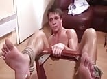 Naked cutie gets his hot feet tickle tortured