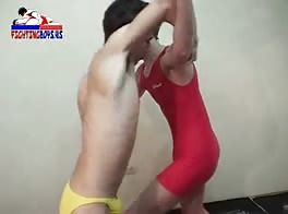 Two twinks wrestle